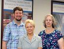 photo of Jason Rogers, Dr. Sherrilene Classen, and Dr. Sandra Winter